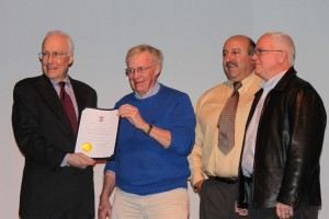 PHS President Jim Garman, treasurer Mike Paglierani and Dave Duggan receive the award.